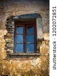window centered on a damaged... | Shutterstock . vector #1202072851
