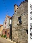 deserted street on an old... | Shutterstock . vector #1202072854