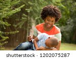 african american mother playing ...   Shutterstock . vector #1202075287