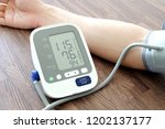 man check blood pressure... | Shutterstock . vector #1202137177