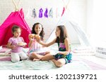 happy girls enjoying fresh... | Shutterstock . vector #1202139721
