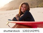 positive sporty woman with... | Shutterstock . vector #1202142991