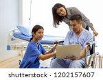 physical therapist explain... | Shutterstock . vector #1202157607