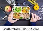 top view showing hands eating... | Shutterstock . vector #1202157961