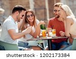 cheerful group of friends... | Shutterstock . vector #1202173384