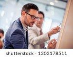 successful businessmen working... | Shutterstock . vector #1202178511