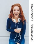 young woman laughing while... | Shutterstock . vector #1202230981