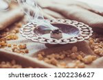 frankincense burning on a hot... | Shutterstock . vector #1202236627