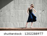 young girl posing against a... | Shutterstock . vector #1202288977
