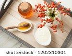 fresh honey and natural milk... | Shutterstock . vector #1202310301