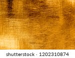 scratches on a metallic gold... | Shutterstock . vector #1202310874