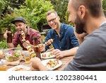 outdoor shot of three friends...   Shutterstock . vector #1202380441