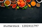 spices and herbs on a wooden... | Shutterstock . vector #1202411797