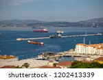 The town and harbour of Gibraltar viewed from up the Rock. Gibraltar is a British Overseas Territory located on the southern tip of Spain. - stock photo