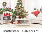 decorated fireplace in a home... | Shutterstock . vector #1202473174
