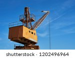 old dockyard crane in front of... | Shutterstock . vector #1202496964
