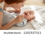 happy young mother bonding with ... | Shutterstock . vector #1202537311