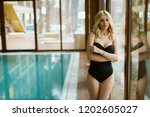 pretty young woman standing by... | Shutterstock . vector #1202605027