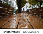 rainy drops on the table in... | Shutterstock . vector #1202607871