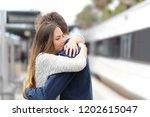 sad couple hugging saying... | Shutterstock . vector #1202615047