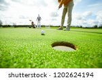 one of golf players going to... | Shutterstock . vector #1202624194
