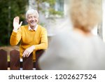 cheerful and friendly mature... | Shutterstock . vector #1202627524