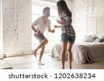 young smiling couple in love... | Shutterstock . vector #1202638234