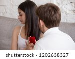 loving man holding red box with ... | Shutterstock . vector #1202638327