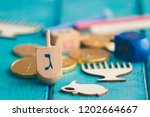 hanukkah dreidels with some... | Shutterstock . vector #1202664667