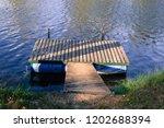 floating docks in the river   Shutterstock . vector #1202688394
