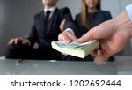 couple giving bribe for illegal ... | Shutterstock . vector #1202692444