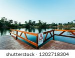 wooden jetty with danger sign... | Shutterstock . vector #1202718304