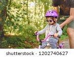 father teaches little toddler...   Shutterstock . vector #1202740627