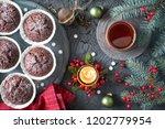 chocolate muffins  tea cup  tea ... | Shutterstock . vector #1202779954