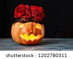 happy halloween pumpkin head in ... | Shutterstock . vector #1202780311