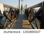venice dock perspective   Shutterstock . vector #1202800327