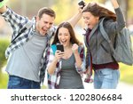 three excited students checking ... | Shutterstock . vector #1202806684