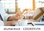 close up young hipster man hand ... | Shutterstock . vector #1202835154