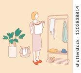 a woman is wearing a coat... | Shutterstock .eps vector #1202838814