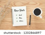 notepad and text new year goal... | Shutterstock . vector #1202866897