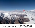 aerial view of snow himalayas... | Shutterstock . vector #1202867584