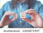 woman giving rating with happy... | Shutterstock . vector #1202871937