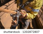 closeup rope access industry... | Shutterstock . vector #1202872807