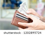 hand of men use money from... | Shutterstock . vector #1202895724