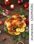 roasted christmas chicken or... | Shutterstock . vector #1202903281