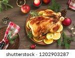 roasted christmas chicken or... | Shutterstock . vector #1202903287