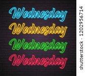 wednesday letter neon light... | Shutterstock .eps vector #1202956714