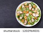 plate of chicken caesar salad... | Shutterstock . vector #1202964031