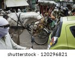 Small photo of VARANASI, INDIA - AUGUST 13,: unidentified people caught up in a traffic jam of horse carts, cycle rickshaws, scooters, cars, pedestrians, and noisome fumes on August 13, 2011 in Varanasi, India.