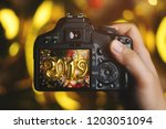 taking picture with camera.... | Shutterstock . vector #1203051094